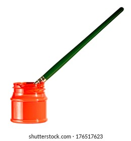 Green paintbrush in red paint can over white background