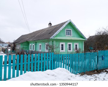 Green painted colorful Russian izba rural house