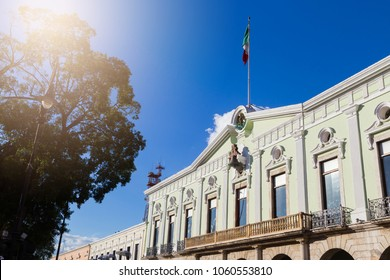 Green palace of government on the plaza in old city Merida, Mexico