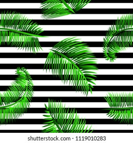Green palm leaves seamless pattern, on black and white striped background. Tropical texture for web and print design, cover, poster.