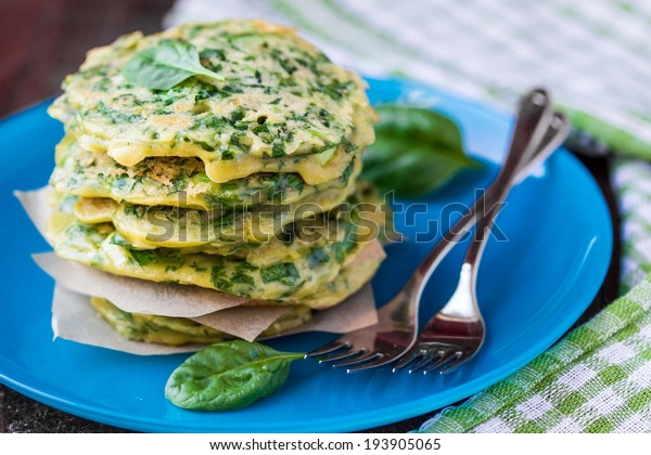 Green pancakes with herbs parsley, spinach, onions, delicious summer snack, spring breakfast