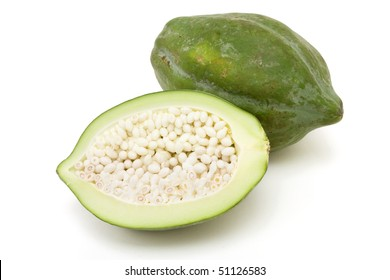 Green Papaya popular in Thai cooking and salads against white background.