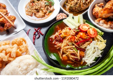 Green papaya salad with grilled chicken, slide grilled pork salad and spicy shredded bamboo shot salad. Thai northeast food.