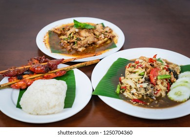 Green papaya salad with grilled chicken, Spicy Grilled Pork Salad, Nam Tok Moo. Thai northeast food.