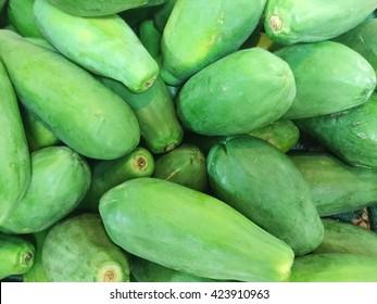 Green papaya for sale at market