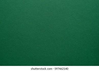 Green paper background. Grain texture art paper in a high resolution. Emerald green. Fine arts paper.