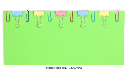 Green paper with binder clips