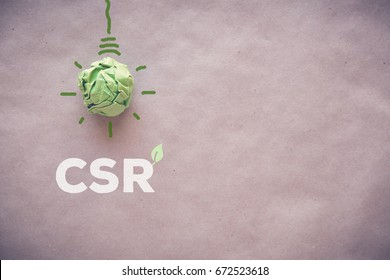 Green paper light bulb with CSR, Corporate social responsibility