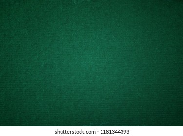 Green paper, a sheet of dark green shaded cardboard for background