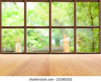 Green park garden view from wooden window