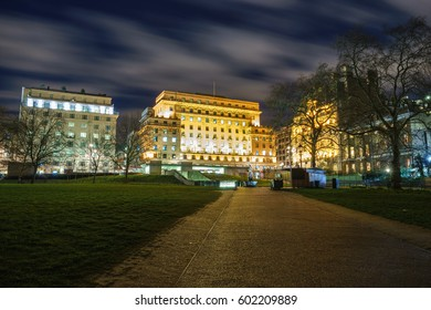 Green park station at night viewed from the pathway of Green Park near Buckingham palace