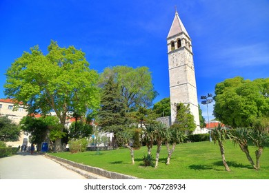 Green park and tall belfry with Venetian architecture in Split, Croatia