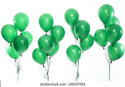 Green party balloons on the white background.