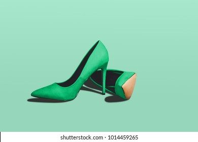 Green pastel high heels isolated on a bright green pastel background. Fashion concept, catwalk. A modern and fashionable shoe store.