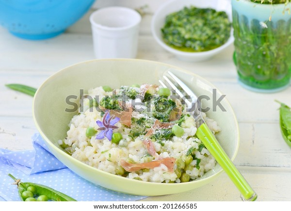 green pea risotto with pesto sauce. selective focus