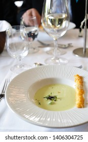 Green pea soup with cheese bread stick.
