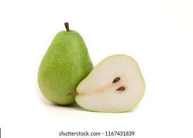 Green pear and half on isolated white background closeup