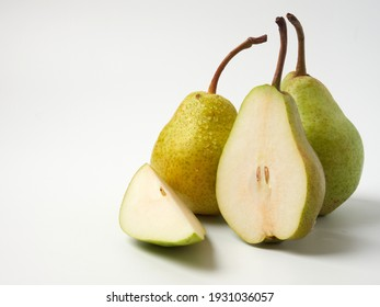 Green pear with a leaf isolated on white. Pear Clipping Path. Professional studio photo
