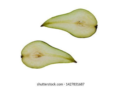 Green pears with the nucleolus, sliced in half. Delicious juicy, fresh, green pear.