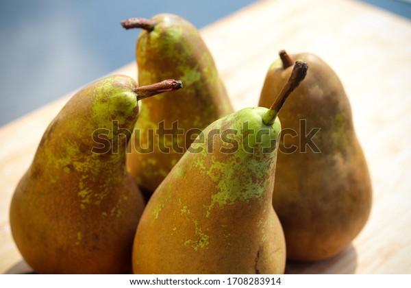 Green pears on a wooden board