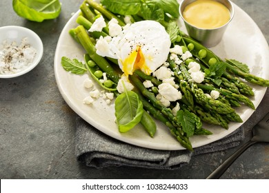 Green peas and asparagus with poached egg and feta for breakfast