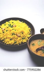 Green peas Basmati rice or matar pulav with added yellow colour, served with plain dal tadka