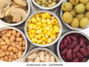 Green peas, beans, corn, olives and mushrooms in tin cans