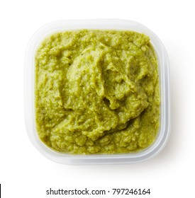 Green peas and broccoli baby puree in plastic container isolated on white background, top view