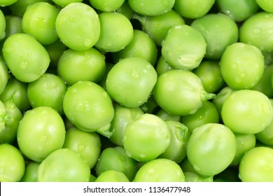 Green peas macro close up background. Horizontal photo of many peeled pea lying on the surface.
