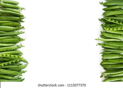 Green peas on a white background. Green peas at border of image with copy space for text. Fresh green peas on a white background.