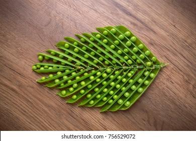 green peas, open pea sticks