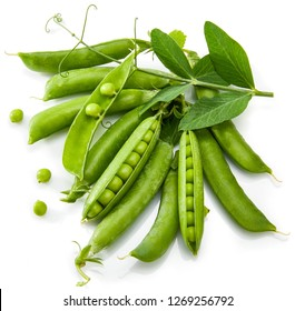 Green peas with twig leaf and pods. Vegetable still life, isolated on white background.