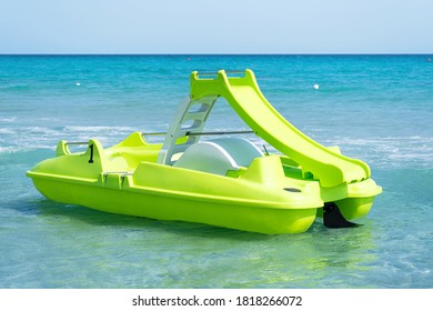 Green pedal boat on Sardinian sea in a turquoise sea. Pedalboat