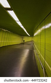 green pedestrian tunnel with neon lights