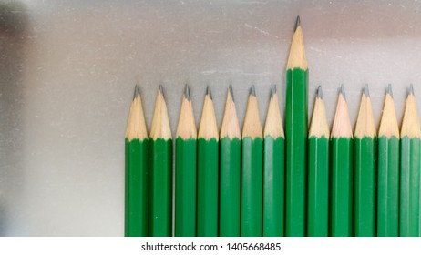 Green pencil that emerges from the arrangement  Compare with  People with outstanding abilities  Have good work performance  Suitable for considering promotion or receiving high returns in organizatio