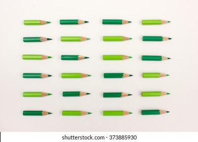 Green pencils in order - organization, teamwork, team strategy concept