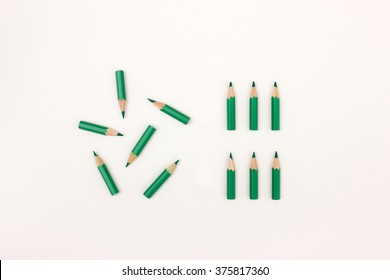 Green pencils unordered and ordered - image to visualize chaos vs order, change, organization, putting things in order