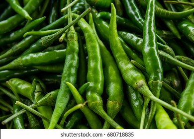 Green pepper or chili from the farm, Close up or macro fresh beautiful Green peppers on the market texture and background, a lot of chili on basket for trader and business and establishment