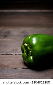 Green pepper on a wood table.