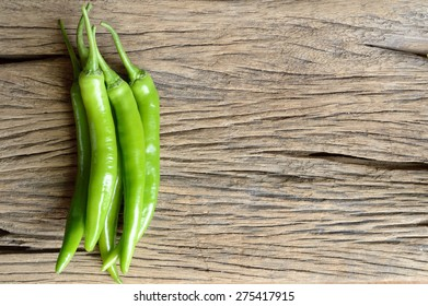 green pepper on wooden background