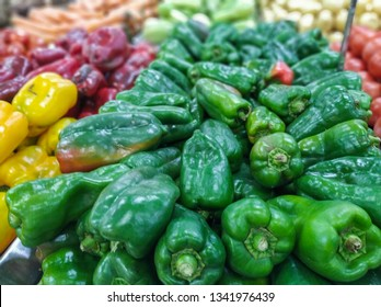 green peppers for sale in supermarket in hortifruti section, with unfocused background