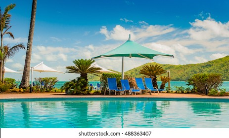 Green Pergola and deck chairs by the pool at Daydream Island Resort, Queensland