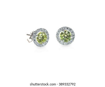 Green Peridot and diamond earrings isolated on white