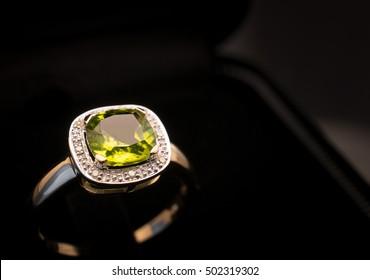 green peridot Jewel gemstone ring on black background