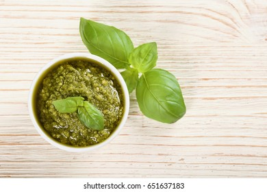 green pesto on a wooden background