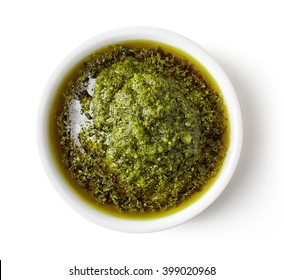 Green pesto sauce isolated on white background, top view
