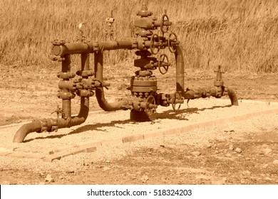 green petroleum machinery and red handwheel, closeup of photo
