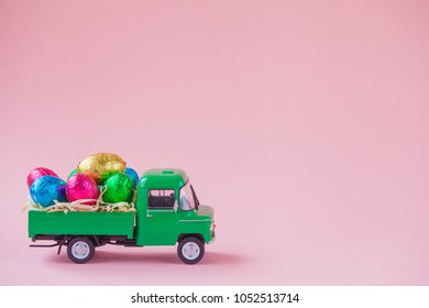 Green pickup toy carrying Easter Egg chocolates.