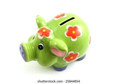 green piggy bank close up isolated in studio