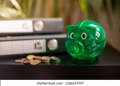 Green piggy bank and folder